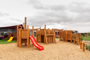 children outside playground image of nido child care centre in wyndham vale